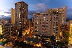 Hawaiian Nights (mrbrkly) Tags: architecture night buildings lights hawaii cloudy waikiki nighttime