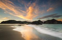 Looking back (Nick Twyford) Tags: sunset sea newzealand seascape beach clouds blacksand nikon rocks wideangle auckland nz northisland westcoast whatipu lateafternoonlight colourimage leefilters 1024mm d7000 lee09nd lee06gndhard lee06gndsoft