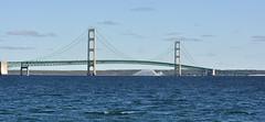 Mackinac Bridge (Seeing Visions) Tags: morning usa cars water clouds mi america boat us unitedstates michigan lakemichigan vehicles trucks buoys mackinacisland lakehuron mackinacbridge hydrofoil roostertail straitsofmackinac 2013 susspensionbridge raymondfujioka