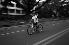 DSC00892 (cess044) Tags: road street city school bw white black up bicycle campus movement university afternoon ride metro weekend sony philippines sunday wide sigma manila diliman alpha amateur quezon beginner quezoncity nex metromanila 2013