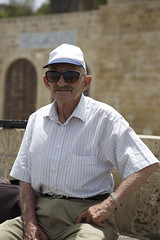 (Caitlin H. Faw) Tags: light shadow portrait man color hat sunglasses june canon eos israel sitting watch ears jaffa moustache 5d yafo markiii 2013 caitlinfaw caitlinfawphotography