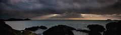Rhoscolyn Beacon at Sunset (Edward W Roberts) Tags: light sunset clouds rays beacon rhoscolyn
