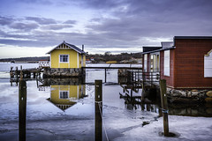 Yellow And Red Harbor Houses (Mabry Campbell) Tags: blue winter red seascape cold reflection ice water yellow marina photography coast harbor photo marine europe photographer image fav50 cloudy sweden january fav20 redhouse coastal photograph sverige pilings 40mm scandinavia fav30 frozenwater fineartphotography f40 waterscape yellowhouse 160 halland architecturalphotography harborhouse commercialphotography fav10 ef1740mmf4lusm 2013 fav40 fav60 architecturephotography houstonphotographer sec skintebo mabrycampbell january12013 201301011846