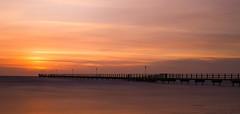 Skrea sunset (Joakim Berndes) Tags: ocean bridge sunset cloud sun water strand canon landscape photo horizon natur filter nd sverige westcoast geotag havet joakim brygga falkenberg västkusten skrea berndes canon6d adobephotoshopexpress jberndes joakimberndes