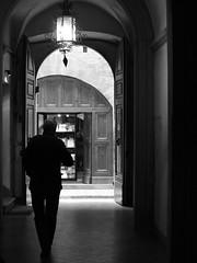 sneaking out (Carine&Tom) Tags: shadow bw italy florence italia tuscany firenze toscana toscane santospirito italie oltrarno