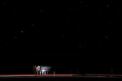 Stars are winking above (Mitch Tillison Photography) Tags: longexposure blur stars photography lowlight route66 highway texas nightshot traffic motorway billboard amarillo nighttime fantasy photograph taillights i40 adultnovelty explored tamron18200 starrysky mitchtillison pentaxk3