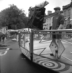 St Giles' Fair (David Stumpp |[o]| Photography) Tags: street uk greatbritain light england people bw white podcast black 120 6x6 tlr film monochrome saint rollei rolleiflex zeiss photoshop balloons square photography lights daylight focus day natural unitedkingdom tmax retro human 80s oxford carl stuffedanimals epson medium format mf rides manual grayscale 35 interest oxfordshire available stgilesfair nationalgeographic planar twinlensreflex oxon 75mm kodaktmax homedeveloped fpp creativesuite 35f v500 cs6 photoscanner filmphotographyproject