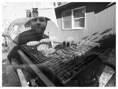 Grillmaster: double exposure (daveelmore) Tags: camping bw food yard river blackwhite cabin friend doubleexposure grill burgers anthony hotdogs memorialdayweekend grillmaster mzuiko918mm
