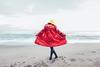 Miss Munroe conjures up the sea (Sator Arepo) Tags: beach rain canon back 5d raincoat markii 1635mm