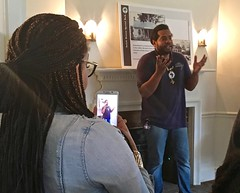 Tour Downstairs - Keenan Holmes (Montgomery Parks, MNCPPC) Tags: tour visitor kennan holmes josiah henson park black history month rockville february winter iphone taking photo interpretive panel fireplace light house indoors room
