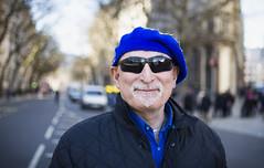 Cheerful Protester (Tom Houlihan) Tags: streetportrait strangers standupfortheeu eu protest portraiture beard sunglasses heart beret blue bokeh london centrallondon naturallight