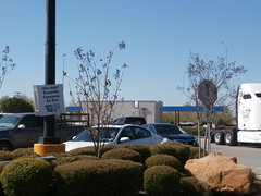 Rear view of new fuel center, with old security camera sign in the foreground (l_dawg2000) Tags: 2000s 2017construction apparel departmentstore desotocounty discountstore fuelcenter groceries mississippi ms olivebranch retail walmart unitedstates usa