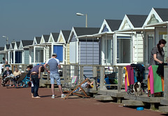 Beach huts at St Annes - 5 (Tony Worrall) Tags: north country place visit area county attraction open stream tour urban candid people person capture outside outdoors caught photo shoot shot picture captured picturesinthestreet photosofthestreet resort england english northwest town northern location lancs lancashire uk fylde fyldecoast stannes beach huts sunlit relax hut sunny holiday holidaytown beachhuts stannesbeachhuts
