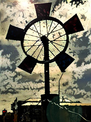 The Bike Wheel Windmill (Steve Taylor (Photography)) Tags: wheel windmill wire art digital black contrast red metal newzealand nz southisland canterbury christchurch cbd city silhouette cloud sunny sun sunshine bike trafficlights