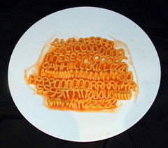 Letraseti Spaghetti (Ian Dennis) Tags: yellow red italy closeup white food restaurant indoor eat plate tasty pasta meal lunch dinner italian delicious ketchup spaghetti alphabetti letraset