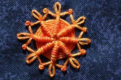 Embroidered Flower (steve_whitmarsh) Tags: craft blue orange art web stitch fabric macro closeup orangeandblue macromondays