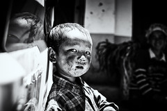 the looks that haunt~ Yunnan (~mimo~) Tags: china boy portrait people blackandwhite blur reflection smile face photography eyes asia child mother streetphotography documentary dirty yunnan ethnicminority mimokhairphotography thelooksthathaunt Potd:country=menaen potd:country=menaar