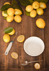 """Fresh Lemons in the Kitchen (""""The Wanderer's Eye Photography"""") Tags: life above summer stilllife food india colour detail kitchen fruits up yellow vertical canon studio photography cuisine eos restaurant photo wooden leaf juicy still lemon italian interiors raw view image artistic top vibrant no object board bangalore creative indoor bowl fresh lemons meal inside block produce appetizer concept dslr karnataka sour edible softbox topview reflector freshness digitalphotography refreshment ingredient foodphotography diffusedlight citrusfruits kitchenphotography tabletopphotography canoneos450d bangalorephotographers canoneosrebelxsi rubenalexander thewandererseye"""
