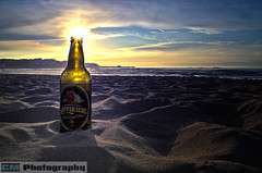 Don't be fooled (C.M_Photography) Tags: sunset sky sun holiday green beach bottle drink label