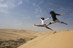 Dancing on the Dunes (Fr4nchito) Tags: africa motion fun sand ballerina afternoon dunes dune dancer afrika movimento namibia sabbia mosso walvisbay divertimento pomeriggio