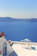 Santorini. What Else? (Allard Schager) Tags: blue white seascape rooftop landscape islands nikon chairs peaceful calm september santorini greece caldera vista iconic cyclades mediterraneansea thira tranquilscene griekenland firostefani aegeansea cycladen 2013 middellandsezee touristdestination pictoresque d700 nikond700 nikkor2470mmf28 allardschagercom aegeschezee
