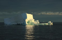 Iceberg Illumination Sunset or Sunrise...Loosing Track of Time in Antarctica Terra Nova Bay Ross Sea (eriagn) Tags: travel blue sea summer cloud snow history ice expedition nature beauty rock landscape photography wildlife antarctica science glacier southern remote iceberg geology exploration continent survival isolated longitude midnightsun historicalsite protected vast terranova captainscott adeliepenguin tabular rosssea depravation antarcticexploration thelongestwinter dawnfirstlight eriagn ngairelawson ngairehart northernparty
