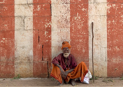 Old Sadhu Squatting In Front Of A Temple, Mahabalipuram, India (Eric Lafforgue Photography) Tags: voyage travel red wallpaper portrait people india man color colour horizontal outside outdoors temple day religion fulllength stick rays copyspace turban hindu hinduism tamilnadu safran oneperson sadhu southindia mahabalipuram onepeople mamallapuram oneman colorimage lookingatcamera indianpeople onemanonly saduh oneadult a702112
