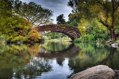 New York Central Park Footbridge in the Fall.jpg (Peter L Giordano) Tags: newyorkcity trees newyork reflection nature water weather architecture clouds landscape pond flora place unitedstates centralpark manhattan country bridges geo genre pictorial 201306 201209 201305 mpcaward mpccategory mpcpictorial mpcdigital3rdplace mpcpictorialprint mpcyearmonth