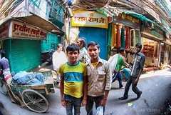 Young friends (Soma Images) Tags: street new old travel friends boy portrait india jason green boys smile kids children photography kid eyes friend warm child friendship market brothers delhi indian photojournalism images commercial license use soma hindu cultural hindi scruff chandni chowk somaimages somaimagescom