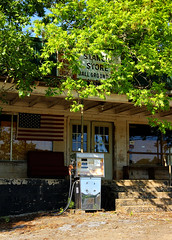 Stancil's Store: Standing Guard (Samantha Evans of Sam Evans Pix) Tags: wood blue red white black tree green window glass station sign metal architecture stairs canon ga reflections georgia advertising wooden store doors americanflag gas gasstation advertisement porch americana cinderblock checkerboard mica smalltown kerosene countrystore purina purinachow tamron1750 canon60d ballground ballgroundga stancilsstore kerosenepump micaga