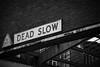 Dead Slow (Chelsea DeBonis) Tags: street uk greatbritain england blackandwhite bw london monochrome sign warning canon dead slow market unitedkingdom britain meat smithfield smithfieldmeatmarket bwlondon canon5dmarkiii 5dmarkiii