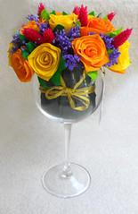 composizione floreale in calice di vetro
