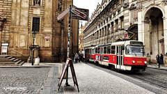 The entrance to Charles Bridge in Prague (VINJABOND.COM) Tags: street travel bridge architecture train europe prague tram wanderlust backpacking czechrepublic charlesbridge worldtravel vision:outdoor=0943 vision:car=0661 vision:street=0883