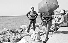 Brits Abroad (forayinto35mm) Tags: blackandwhite holiday film beach 35mm 50mm spain playa espana ilfordhp5 bikini hp5 dynax costabrava benidorm brits minoltadynax5 blackandwhitefilm ilfordfilm