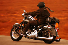 A man riding a motorcycle on an open road (TouTouke - Nightfox) Tags: road travel blue boy sky urban cloud man motion tree male guy sunglasses wheel speed landscape outside person rebel one drive chopper view ride adult outdoor transport young machine fast cruising move wear motorbike single transportation biking motorcycle vehicle driver biker motor asphalt velocity rider 20s caucasian