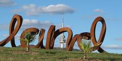 Black Mt Tower and the sculpture (spelio) Tags: australia arboretum telstra april canberra act 2013