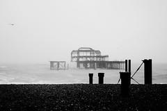 (aimz_durrant) Tags: sea blackandwhite beach rain weather photography brighton sony shingle pebbles brightonbeach derelict destroyed a65 thewestpier sonya65