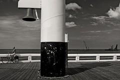 Ostende Bike (Virgil Mlesnita) Tags: city travel summer blackandwhite bike seaside belgium bell ostende