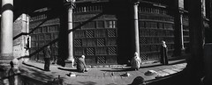 Pryier, The Mosque of al-Mu'ayyad, Islamic Cairo, Egypt 2001 (Zbigniew Kosc) Tags: people blackandwhite man architecture photography islam religion egypt documentary mosque panoramic cairo islamic zbigniewkosc