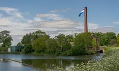 flying the colours (stevefge) Tags: afferden maasenwaal nederland netherlands gelderland chimney water landscape flag nl reflectyourworld nederlandvandaag