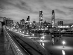 Santiago after rain (World Traveller Photography) Tags: chile park city santiago sky urban southamerica water monochrome rain night clouds buildings skyscrapers flood vitacura parquebicentenario grantorresantiago