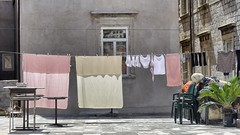 It must be Monday (halifaxlight) Tags: street houses windows backlight reflections chairs croatia sunny laundry pastels tables dubrovnik oldcity drying washingline