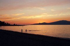 Spanish Bank (m.tones) Tags: ocean sunset summer orange canada mountains beach nature water silhouette yellow vancouver digital swimming landscape photography golden evening twilight nikon bc pacific columbia hour spanishbanks british leisure colourful dslr nicecolours 2013 d700