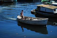 Fisherman (CarlaUrbanetto) Tags: ocean sea water boat sailing fisher sail worker