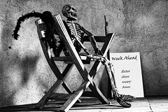 Relax Those Bones (Trudy -) Tags: bw halloween sign relax skeleton chair eerie spooky bones scare fright