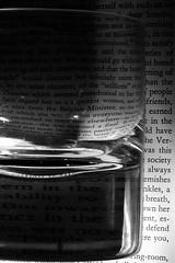 dead reckoning (JonathanCohen) Tags: blackandwhite distortion glass monochrome book letters photochallenge 2013photochallenge