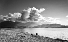 The luxury to have a whole beach for yourself (VillaRhapsody) Tags: sea man beach clouds solitude mediterranean thinking rodin fethiye babadag calis challengeyouwinner kocacalis