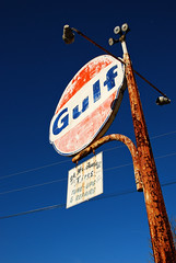 Old Sign (moke076) Tags: old blue sky orange station sign vintage gulf antique ad rusty gas faded worn oil advertise vision:outdoor=0984 vision:sky=0844