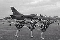 Dancing with the jet.. (PointOfUPhotography) Tags: blackandwhite cute love girl monochrome airplane dance hoodie ballerina action christina stripes jet airforce triple edit multiplication christinavukel vukel monomonday
