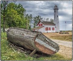 Sturgeon Point Lighthouse #2 (ammozug) Tags: landscape woodboat lighthouse redshutter sturgeonpointlighthouse harrisville mi